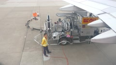 Airplane refueling pump and personnel, close view from top, man disconnecting Stock Footage