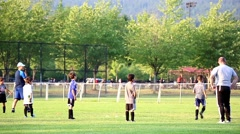 Children practicing football skill Stock Footage