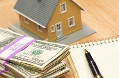 House and Money with Pad of Paper and Pen Stock Photos
