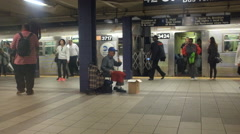 A Chinese performer plays erhu at a subway station in Manhattan - stock footage