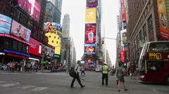 A tour bus drives past Times Square in New York Stock Footage
