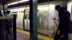 Man with duffle bag walking subway train platform station slow motion 4K NYC Stock Footage