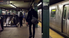 Man with duffle bag walking on subway train platform station slow motion 4K NYC Stock Footage