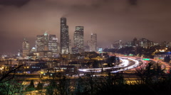 Time lapse of traffic on the freeway looking toward Skyscrapers in Seattle and Stock Footage