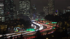 Time lapse of the inner city and traffice on highway 5 in Seattle at night. - stock footage