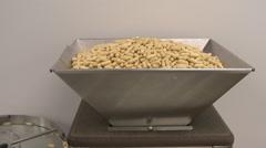 Handheld pan shot of a capsule sorting machine. Stock Footage