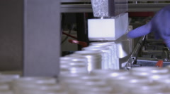 Closeup shot of plastic bottles being filled. - stock footage