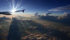 Amazing view from airplane window clouds shadows and sunset - stock footage