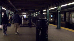 Subway train platform interior West 4th Street A Train entering station 4K NYC Stock Footage
