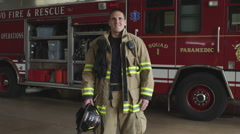 Handheld shot of a fireman in uniform at the fire station Arkistovideo