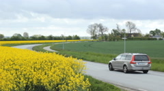 Road rapeseed oil field traffic 2 Stock Footage