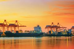 Stock Photo of beautiful twilight sky at shipping port use for vessel ,nautical import and e