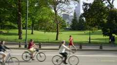 Bicycles Central Park bicyclists riding bikes road with green and trees 4K NYC Stock Footage