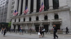 Pedestrians walk outside the New York Stock Exchange at the Wall Street Stock Footage