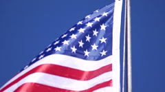 American flag waving in Death Valley at Brigg's Cabin Stock Footage