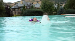 Static shot of a little girls splashing in a pool. Stock Footage