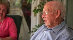 Shot of a happy elderly couple appearing to answer interview questions. - stock footage