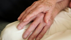A close up shot of an elderly couple holding hands with each other. - stock footage