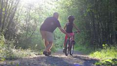 Asian Girl Learning To Ride Bike On Pretty Forest Path Stock Footage