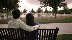 Stock Video Footage of A tracking shot of the back of a couple gazing off into the distance.