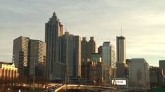 Tilting shot of the Atlanta Skyline down to freeway traffic. Stock Footage