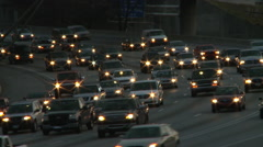 Static shot of traffic on the freeway while the sun barely lights the scene in Stock Footage