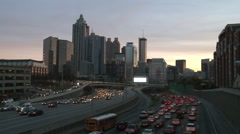 Static, wide shot of the Atlanta Skyline with traffic below in a darkening Stock Footage