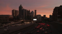 Static, wide, nighttime shot of the Atlanta Skyline with traffic below. Stock Footage