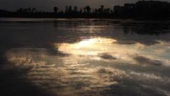 Ripples waving in the lake, and water reflecting sunshine at sunset Stock Footage