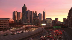 Static, wide, timelapse shot of the Atlanta Skyline with traffic below as the Stock Footage