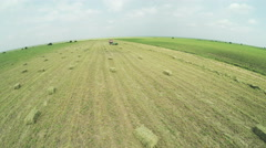 Aerial view over field with bales of lucerne Stock Footage