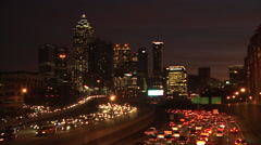 Static, wide, very dark, nighttime shot of the lit up Atlanta Skyline with Stock Footage