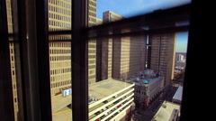 A static shot of the Suntrust Plaza while going up in a fast moving elevator. Stock Footage