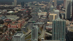 A high angle, pan shot from left to right of the Atlanta Skyline with cars on Stock Footage