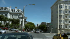 Static shot at intersection on Fulton Street in San Francisco as traffic moves Stock Footage