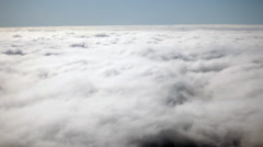View out of the window from Airplane above the clouds flying over San Francisco. Stock Footage