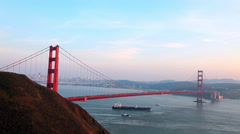 High speed view over looking the Golden Gate Bridge as boats and ships crusie Stock Footage