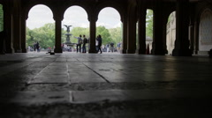 tourists taking pictures silhouettes walking Bethesda Fountain statue 4K NYC - stock footage