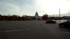 A handheld shot of driving towards the U.S. Capitol Building in Washington DC. - stock footage