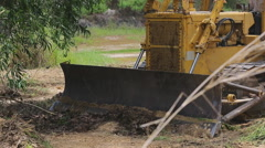 Unidentified worker control Bulldozer to excavator grader removing the ground Stock Footage