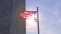 A static shot with a lens flare of an american flag to the side of the Stock Footage