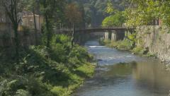 River Cerna and bridge over scenery of spa resort Herculane located in  weste Stock Footage