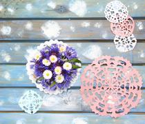 Lovely paper snowflakes and a bouquet of flowers on a blue wooden table, a Ch - stock photo
