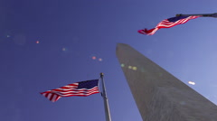 A tilt shot looking up at the Washington Monument on a windy day in Washington Stock Footage