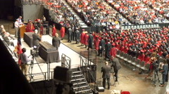 4K slow motion of first graduates heading to podium for diplomas Stock Footage