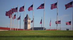 A static shot of a circle of flags with a clock tower in the distance in Stock Footage