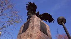A tilt shot of a historic statue of an eagle in the daytime in Washington DC. Stock Footage