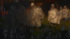 Pan of Korean War Veterans Memorial wall in Washington DC Stock Footage