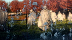 Pan of reflection of soldier statues on the Korean War Veterans Memorial in Stock Footage