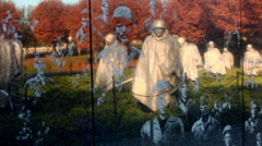 Panning shot of reflection of statues on the Korean War Veterans Memorial wall Stock Footage